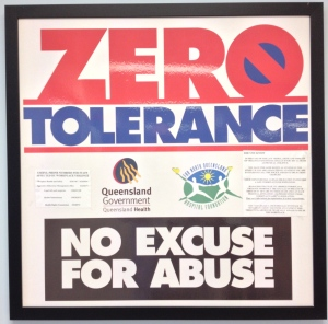 "This shouty ""ZERO TOLERANCE NO EXCUSE FOR ABUSE"" poster hangs in the main corridor of a medical ward, adjacent to the nurses station."
